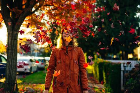 Beautiful girl walking outdoors in autumn. Young woman enjoying autumn weather Banco de Imagens