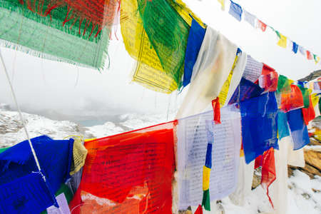 Colorful Buddhist prayer flags at blue sky in Kathmandu valley, Nepal.