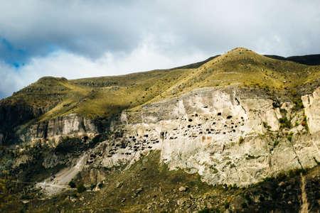 view of vardzia, city built in the rock in georgia.