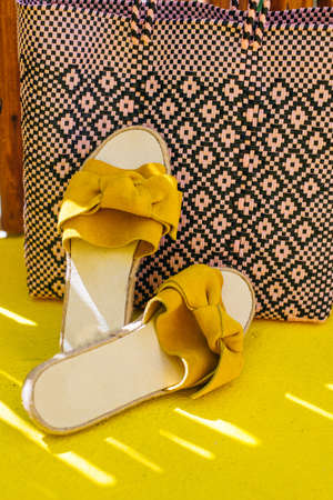legs of a girl in yellow shoes on a yellow floor.