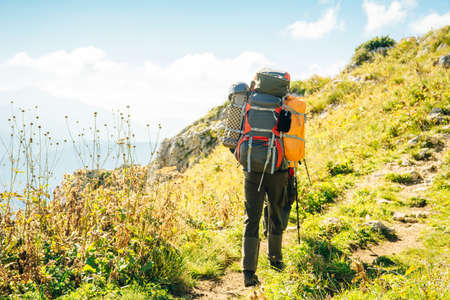 hiker in the Mountains of Republic of Adygea with large backpacks. Russia