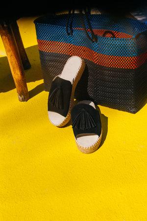 black shoes on the yellow floor in summertime Reklamní fotografie