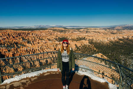 girl traveler on viewpoint in Bryce Canyon National Park in Utah