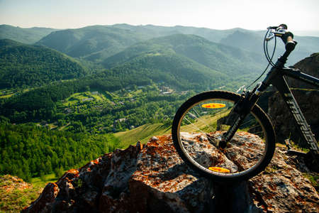 A trip by bike in mountain on the sunset. russia - sep, 2019 Redakční