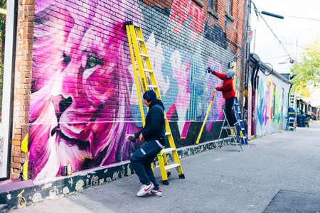 canada, toronto - december, 2019 Graffiti artist spraying the wall Redakční