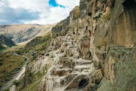 view of vardzia, city built in the rock in georgia Banco de Imagens - 155434869