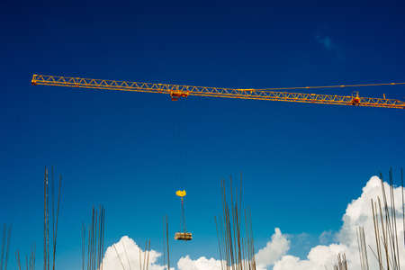 Yellow Industrial Cranes Working on Construction Site Against Blue Sky Stok Fotoğraf