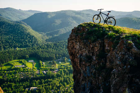 A trip by bike in mountain on the sunset. russia - sep, 2019 Banco de Imagens - 154329042