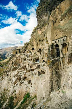 view of vardzia, city built in the rock in georgia Banco de Imagens - 155434876