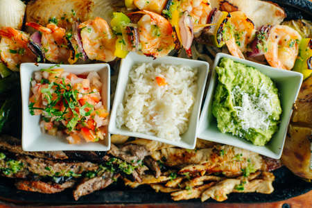 A variety of dishes on a ONE PLATE. Restaurant serving. Top view. mexican food Banco de Imagens