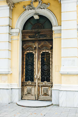 Wooden doors with carved decoration and glass. Reklamní fotografie
