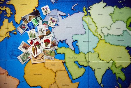 postage stamps on a world map