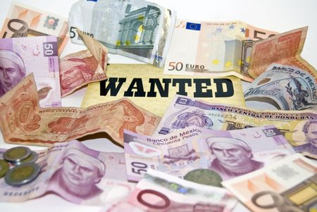 Economic crisis, ejemplified by currency from different countries. Stock Photo - 3367583