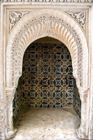 Arabesque architecture at the Alhambra in Granada Spain. photo
