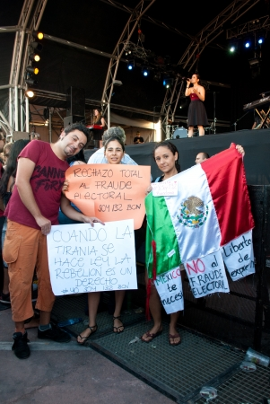 electoral: BARCELONA, SPAIN. JULY 6TH: Unidentified mexicans protest against the electoral fraud in Mexico during Julieta Venegas concert at the Cruilla Music Festival in Barcelona, on 6July2012.