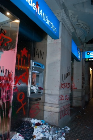 rajoy: BARCELONA, SPAIN  NOVEMBER 14TH  Damaged banks during the European General Strike on 14 November 2012 in Barcelona Spain