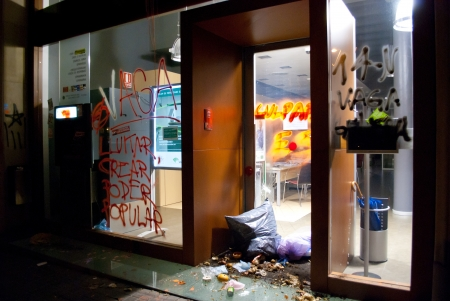 rajoy: BARCELONA, SPAIN. NOVEMBER 14TH: Damaged banks during the European General Strike on 14November2012 in Barcelona Spain.