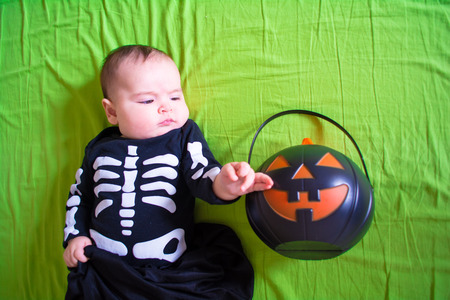 Baby under four months old dressed for Halloween