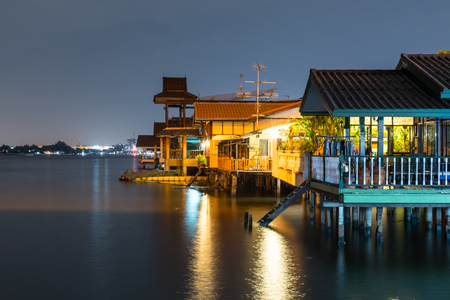 old house near rivercanal in Thailand. Waterfront lifestyle. Cultural water. Stock Photo