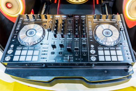 DJ console cd mp4 deejay mixing desk music party in nightclub.