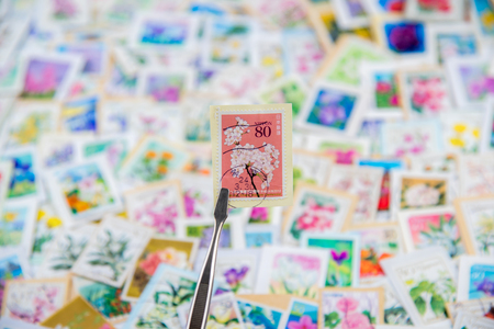 A stamp printed in Japan shows various flowers collection.