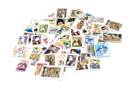 philately: A postage stamp printed in Japan showing a painting of a Japanese people. Editorial