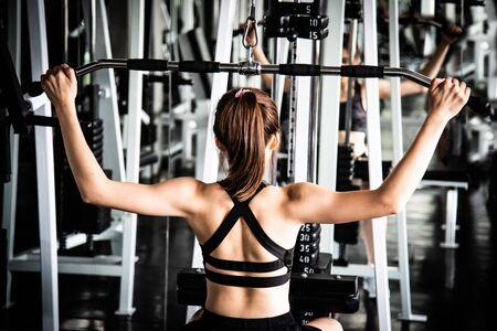 woman exercising building muscles at gym Banco de Imagens