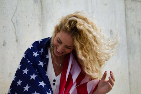 blond girl happy with USA flag 写真素材