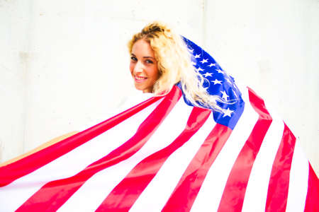 BLOND GIRL WITH USA FLAG 写真素材
