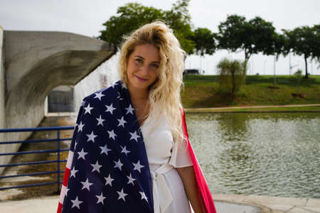 BLOND GIRLS WITH USA FLAG