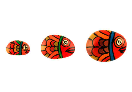 Fish family hand painted peebles isolated in white photo