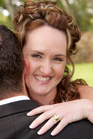 A bride looking over grooms shoulder Stock Photo - 3005044
