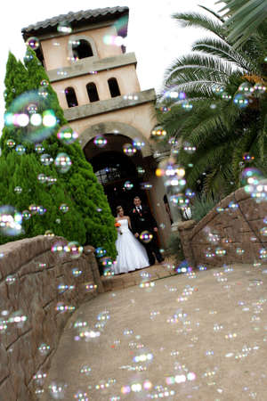 A wedding couple ouside chapel with confetti
