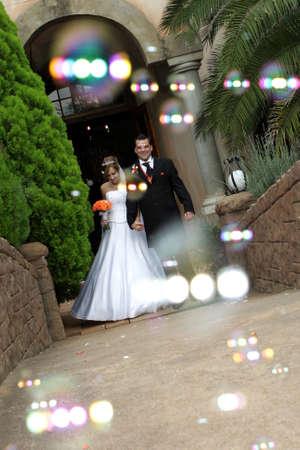 A wedding couple and bubble confetti