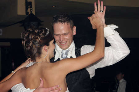 A bride and groom dancing on their wedding day
