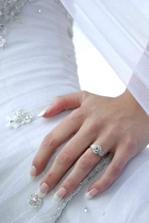 A bride standing with her hand on her hip