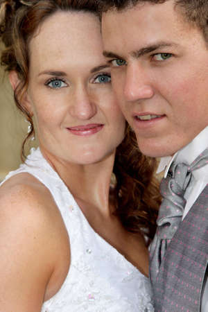 A portrait of a bride and groom standing close Stock Photo - 3077071