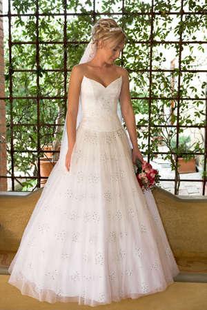 A bride standing in her wedding dress