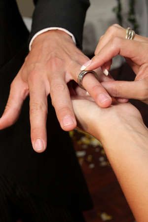 Bride putting on wedding ring
