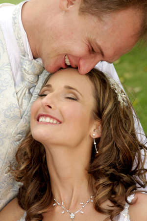 A bride and groom close together in love