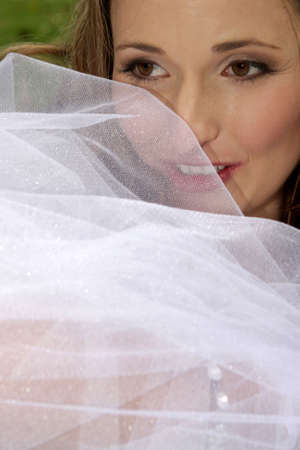 unveiling: A bride with her face behind her veil