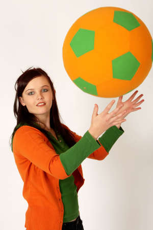 A woman playing with a big ball