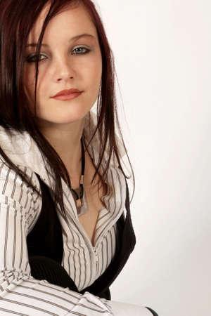 A brunette woman posing for a portrait