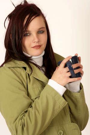 A woman holding a coffee mug  Stock Photo