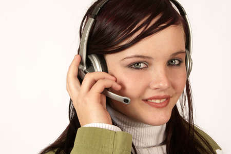A woman with headphones on her ears  Stock Photo