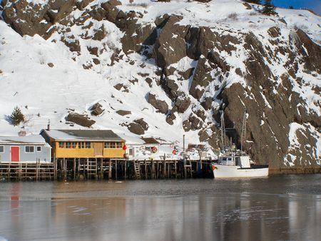 fishing stages next to a frozen harbour