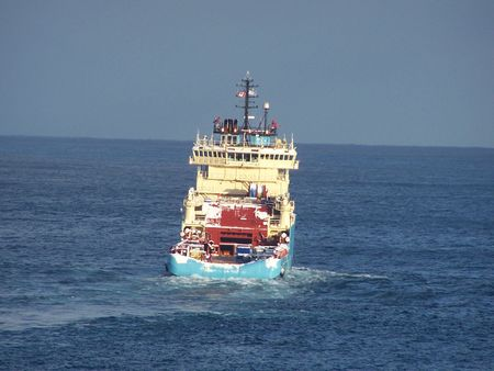 a supply boat that delivers supplies to offshore oil rigs