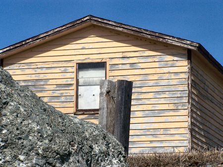 an old abandoned house in a small coastal community in newfoundland canada