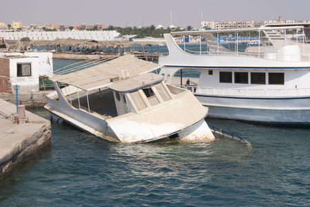 Drowning yacht, ship in the port, Egypt Stock Photo