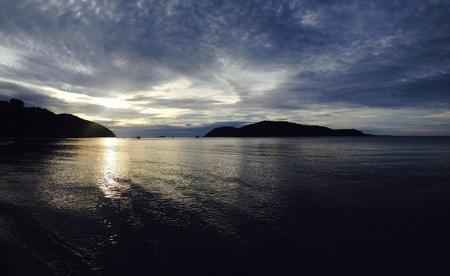 dark: Sunset at the beach with beauty sky